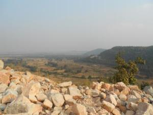 The study site landscape is shown with boulders of the paleosol in the foreground. Quentin Crowley
